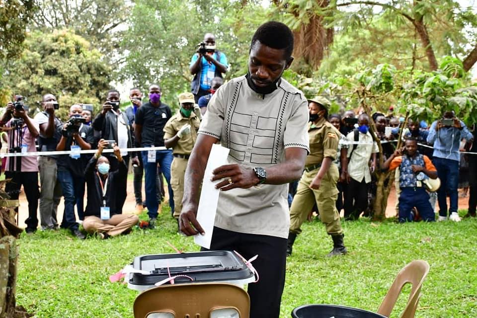 Mr Bobi Wine casting his vote on Thursday